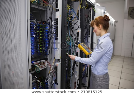 Serious technician using digital cable analyzer on server Stock photo © wavebreak_media