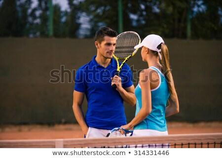 Férfi beszél barátnők teniszpálya portré jóképű férfi Stock fotó © deandrobot