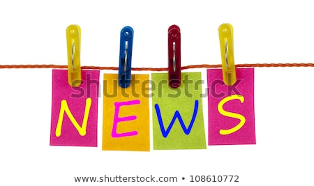 news word on laundry hook stock photo © fuzzbones0