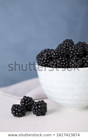 Fresh blackberrys in a bowl  Stock photo © OleksandrO