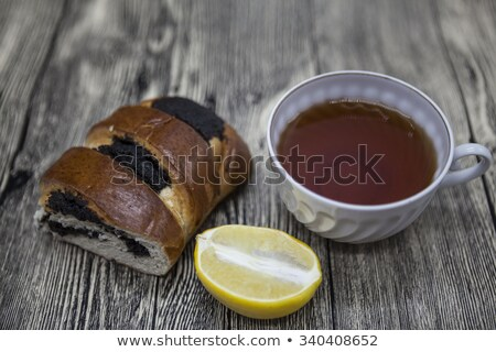 Stock photo: Beautiful composed on wooden background Cup of tea lemon and biscuits