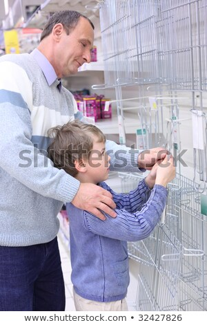 elderly man with boy in store hang grill for roasting on wall Stock photo © Paha_L
