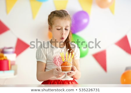Stok fotoğraf: Little Girl Blowing Birthday Candles Blur