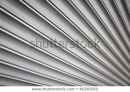 Closed metal shop security shutter close up. Stock photo © latent