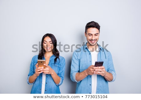 attractive young woman sending a text message stock photo © dash