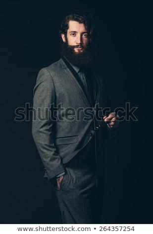 classy man in black wearing glasses posing in dark  Stock photo © feedough