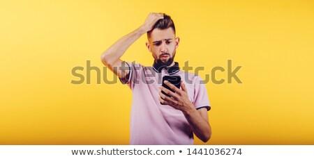 Conmocionado barbado hombre barba perfil Foto stock © deandrobot