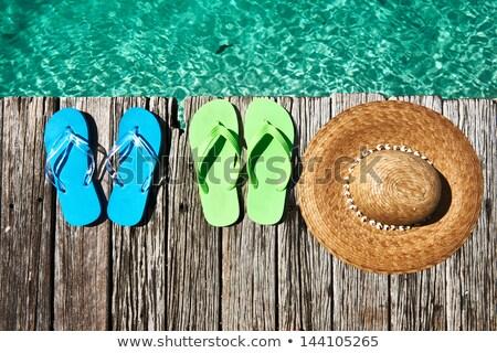 Zdjęcia stock: Beach Hat And Slippers On Pier