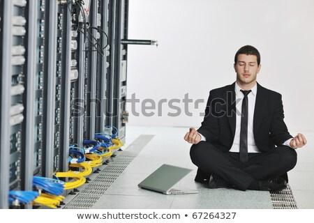 business man practice yoga at network server room stock photo © dotshock