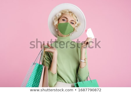 Online shopping concept - beautiful woman with shopping bags and Stock photo © vlad_star