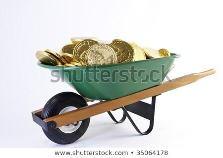 Side view of green wheel barrel Stock photo © stockfrank