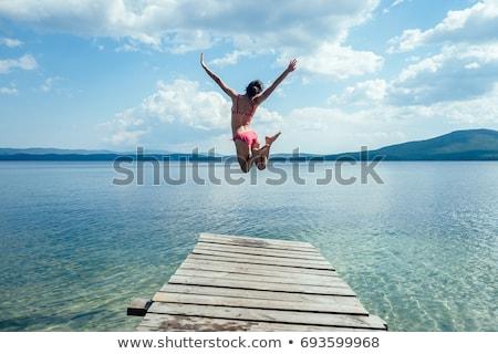Fiú lány fából készült dokk gyönyörű tenger Stock fotó © zurijeta