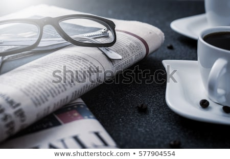 Stock photo: mug of pile magazines