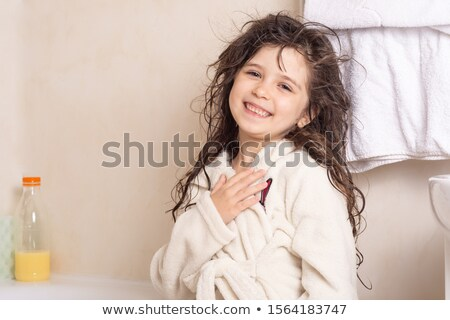 Cheerful little girl with long wet hair Stock photo © ozgur