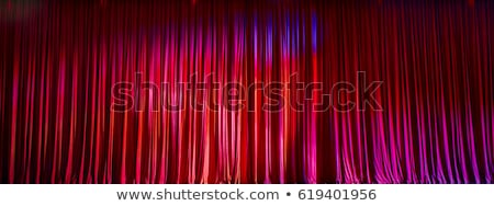 Red stage curtain on black background stock photo © feelisgood
