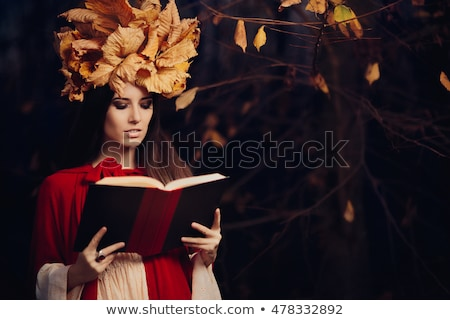 woman with autumn leaves crown reading a book stock photo © nicoletaionescu