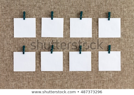 Neat row of hanging blank white notepads Stock photo © ozgur