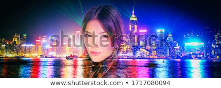 beauty brunette in night scenery stock photo © konradbak