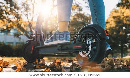Vrouw rijden elektrische asian jonge vrouw Stockfoto © RAStudio