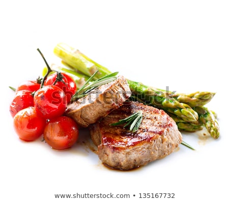 Roast with beef potatoes and asparagus on a white background stock photo © janssenkruseproducti