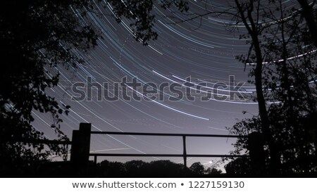 Stars trace circles on the sky with aircraft lights. Stock photo © Vertyr