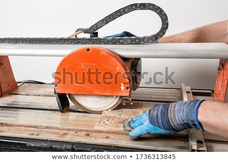 men hands with tile cutters Stock photo © OleksandrO