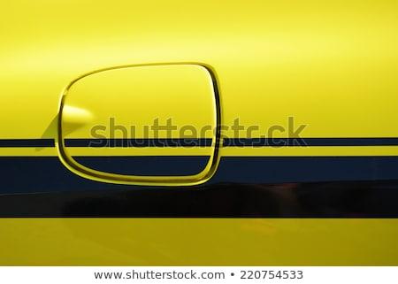 Sarı spor araba gaz kapak kapı spor Stok fotoğraf © njnightsky