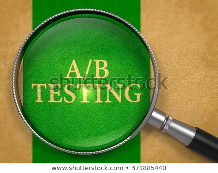AB Testing through Lens on Old Paper. Stock photo © tashatuvango