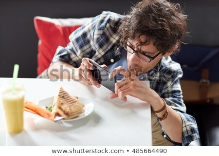 man taking picture of food from mobile phone stock photo © wavebreak_media