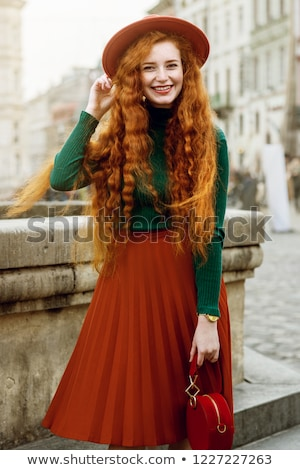 Portrait of young redhead woman wearing dress Stock photo © deandrobot