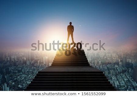 Businessman standing on stairs Stock photo © IS2