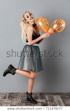 full length image of happy blonde woman in halloween make up stock photo © deandrobot
