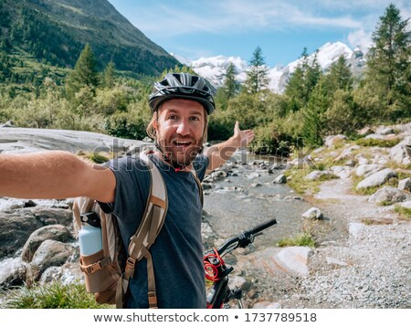 Mountain biker taking in the view Stock photo © IS2