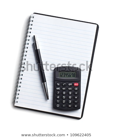 clean sheet of notebook with pen and calculator stock photo © ivelin