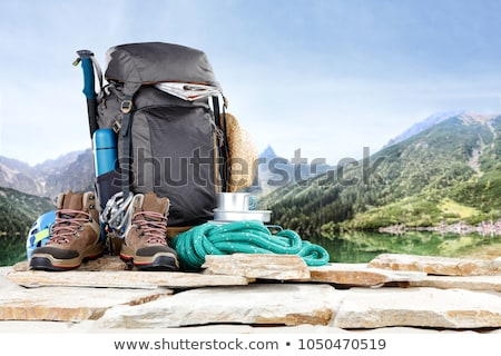 Stock photo: Beautiful young tourist girl with backpack at mountains