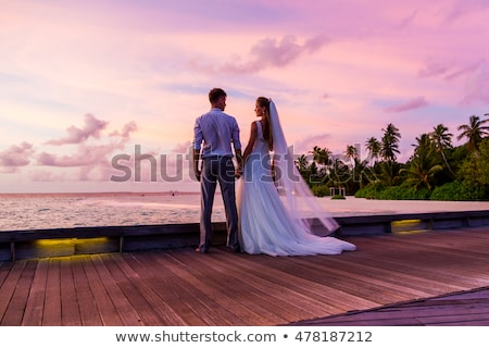 Couple standing on jetty Stock photo © IS2
