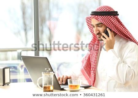 empresario · hablar · teléfono · ordenador · oficina - foto stock © monkey_business
