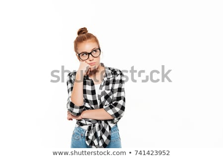 Thoughtful ginger woman in shirt and eyeglasses reclines on arm Stock photo © deandrobot