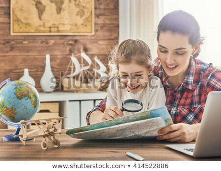A girl looking at a globe Stock photo © IS2