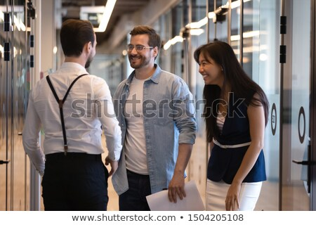 Businesspeople having a discussion in office corridor Stock photo © wavebreak_media