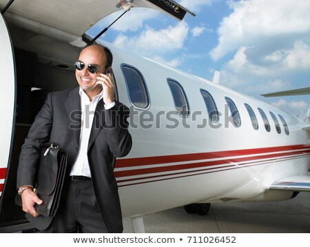 Smiling businessman exiting private jet Stock photo © IS2