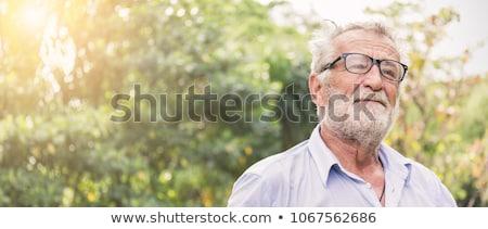 Senior Adult man in garden portrait Stock photo © IS2