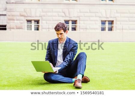 Adam kahverengi ceket yeşil pantolon mavi Stok fotoğraf © robuart
