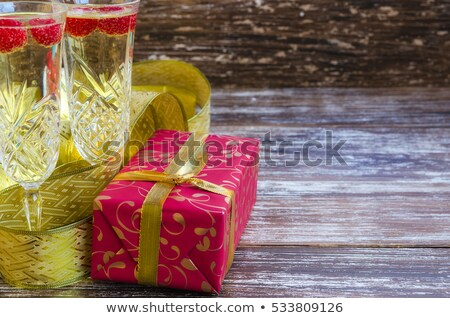 Glasses of champagne with rasberry on thepresent by the Christma Stock photo © dashapetrenko