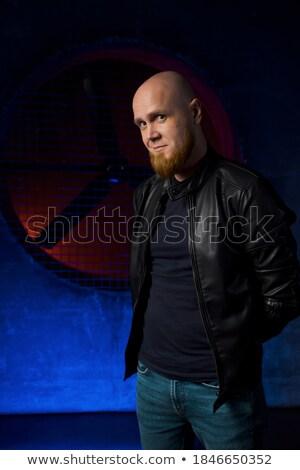 Serious bearded man looking sideways at camera Stock photo © Giulio_Fornasar