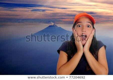 Beautiful Latin teen hispanic girl cap surprise gesture stock photo © lunamarina