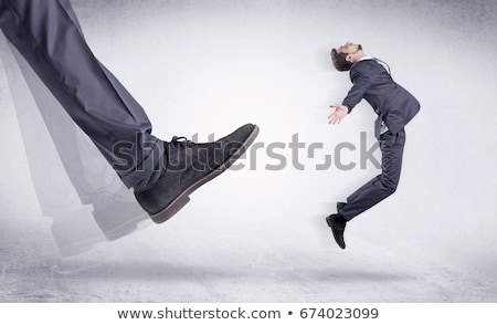 black shoe kicking small man stock photo © ra2studio