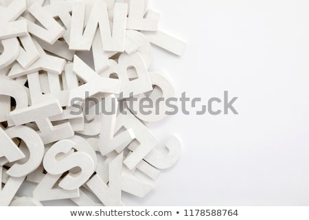 Pile of white painted wooden letters. Typography background composition.  Stock photo © sqback
