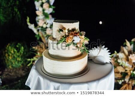 Esküvői torta három padlók gyümölcs kívül este Stock fotó © ruslanshramko