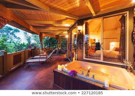 Gyönyörű otthon fa kő külső fedett Stock fotó © iriana88w